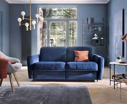 Sofa z funkcją spania w aranżacji pokoju dziennego